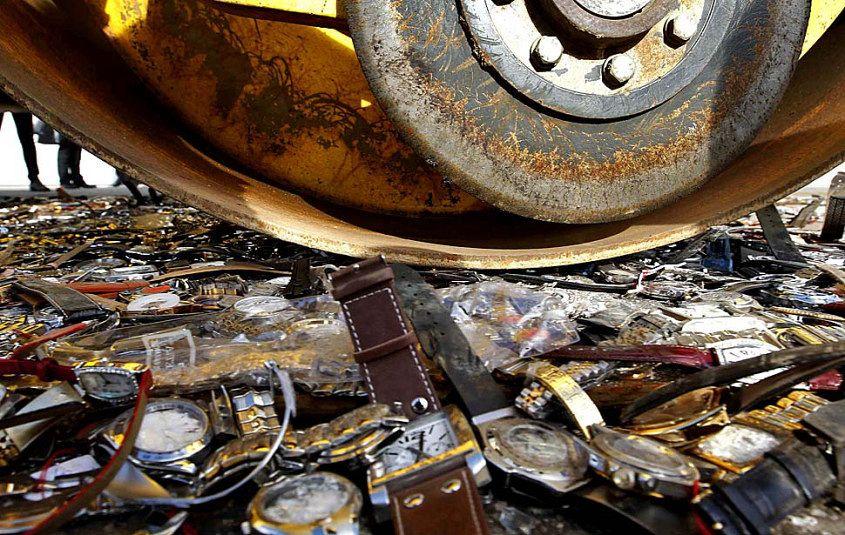 Crushing fake watches