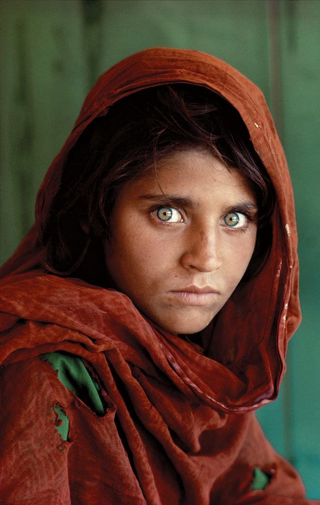 Afghan Girl, at Nasir Bagh refugee camp near Peshawar, Pakistan 1984 The green-eyed Afghan girl became a symbol in the late twentieth century of strength in the face of hardship. Her tattered robe and dirt-smudged face have summoned compassion from around the world; and her beauty has been unforgettable. The clear, strong green of her eyes encouraged a bridge between her world and the West. And likely more than any other image, hers has served as an international emblem for a difficult era and a troubled nation.