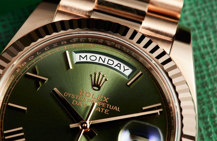 Rolex DayDate 40 with green dial.