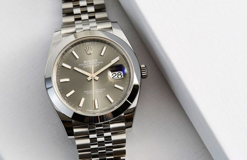 Rolex Oyster Perpetual Datejust 41 in steel (ref. 126300) with dark rhodium dial on Jubilee bracelet.