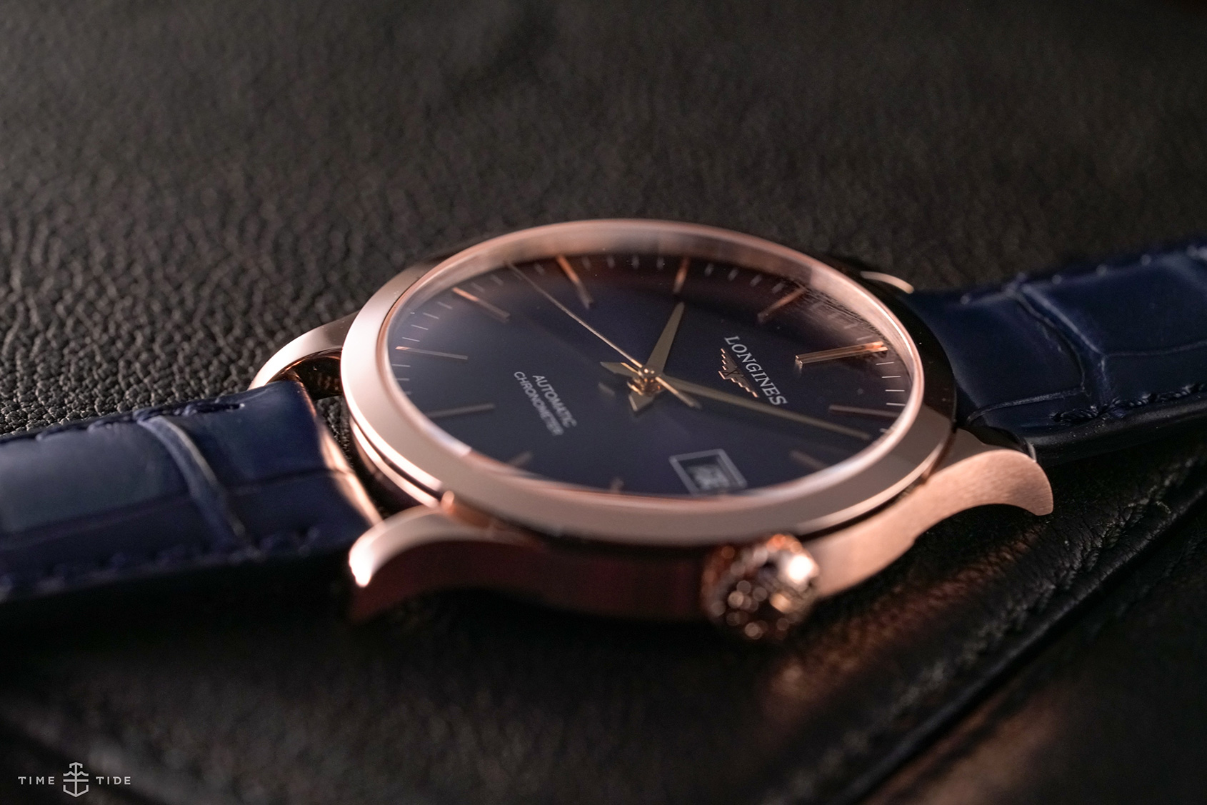 32cafc653 To strap the golden Longines Record to the wrist is a dial-matching blue alligator  leather strap.