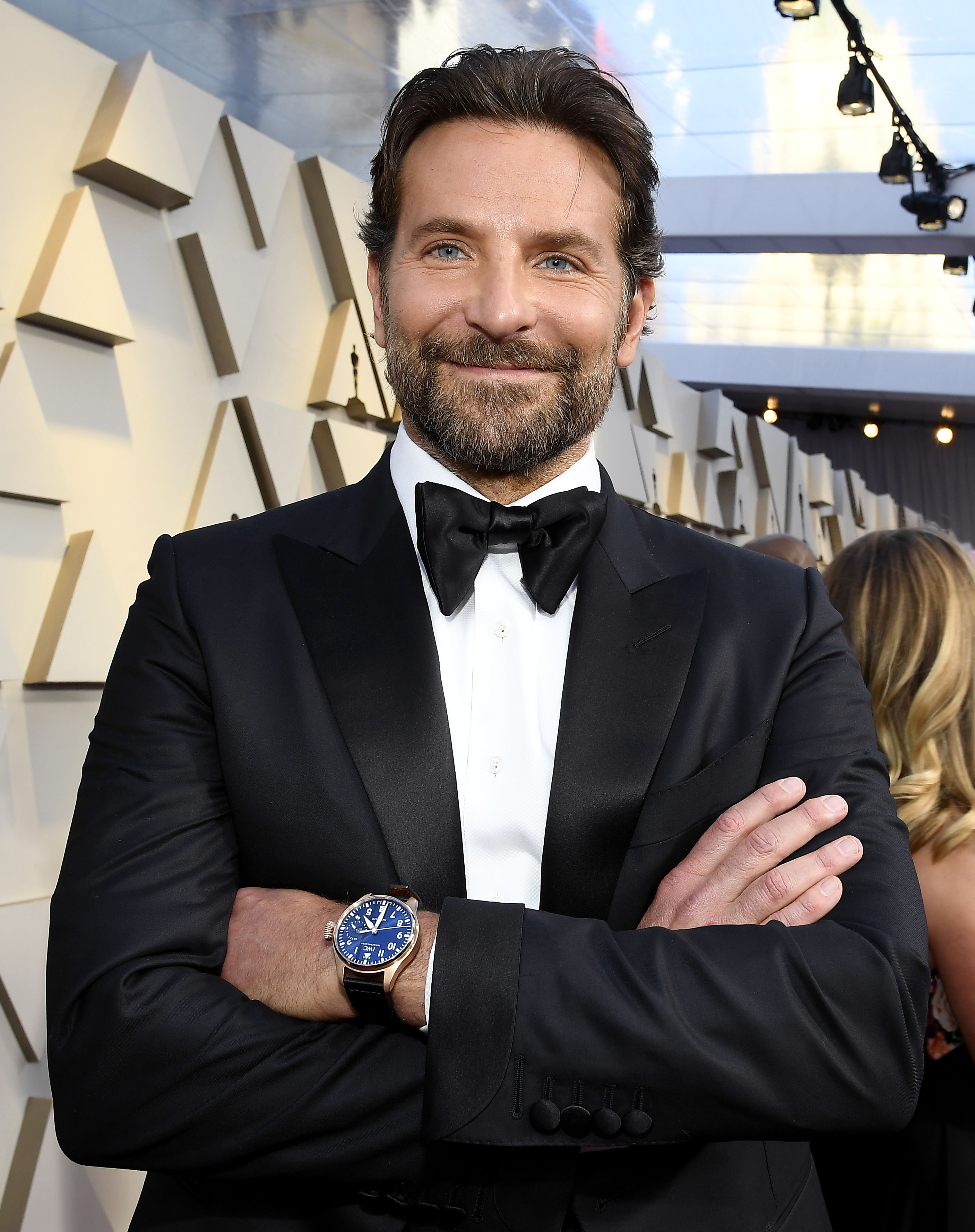LIST: 3 well-dressed men straight up wrist flexing at the ...